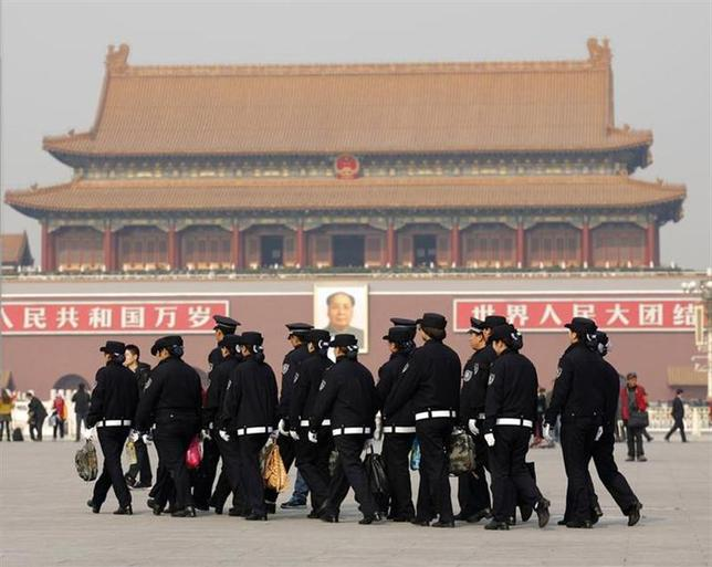 Police patrol around Tiananmen Square in Beijing November 8, 2013. REUTERS/Kim Kyung-Hoon/Files