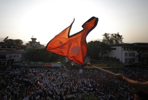 The national flag of Nepal is waved during a mass gathering in Kathmandu May 23, 2012. REUTERS/Navesh Chitrakar