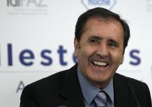 Spain's former golf player Severiano Ballesteros laughs during a news conference in Madrid October 29, 2010 in this file photo. REUTERS/Andrea Comas