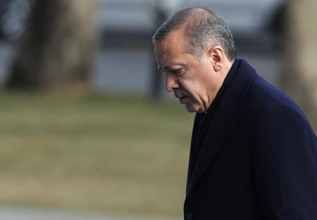Turkey's Prime Minister Tayyip Erdogan arrives at the cabinet meeting in Ankara December 30, 2013. REUTERS/Umit Bektas