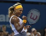 Serena Williams of the U.S. reacts as she defeats Maria Sharapova of Russia during their women's singles semi-finals match at the Brisbane International tennis tournament in Brisbane, January 3, 2014. REUTERS/Jason Reed