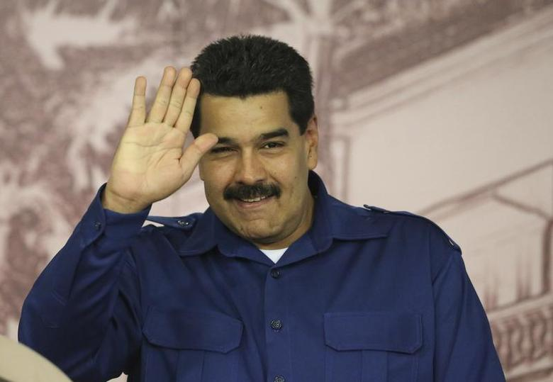 Venezuela's President Nicolas Maduro waves during a news conference in Caracas in this December 30, 2013 handout provided by Miraflores Palace. Venezuela registered an inflation rate of 56.2 percent in 2013, Maduro said on Monday, despite the government's aggressive campaign to reduce prices. REUTERS/Miraflores Palace/Handout via Reuters