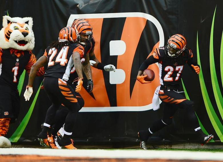 Cincinnati Bengals cornerback Dre Kirkpatrick (27) celebrates with teammates after intercepting a pass and running for a touchdown during the fourth quarter against the Baltimore Ravens at Paul Brown Stadium. Andrew Weber-USA TODAY Sports