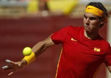 Rafael Nadal of Spain looks at the ball before returning a shot during his Davis Cup World Group semi-final against Jo-Wilfried Tsonga of France at the Cordoba bullring September 18, 2011. REUTERS/Marcelo del Pozo