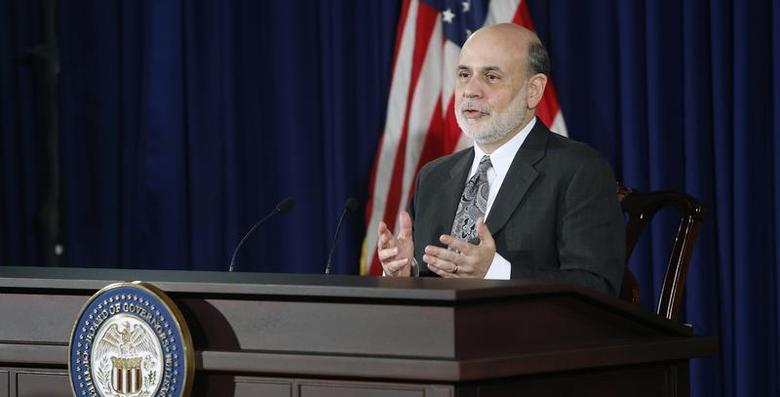 U.S. Federal Reserve Chairman Ben Bernanke responds to reporters during his final planned news conference before his retirement, at the Federal Reserve Bank headquarters in Washington, December 18, 2013. REUTERS/Jonathan Ernst