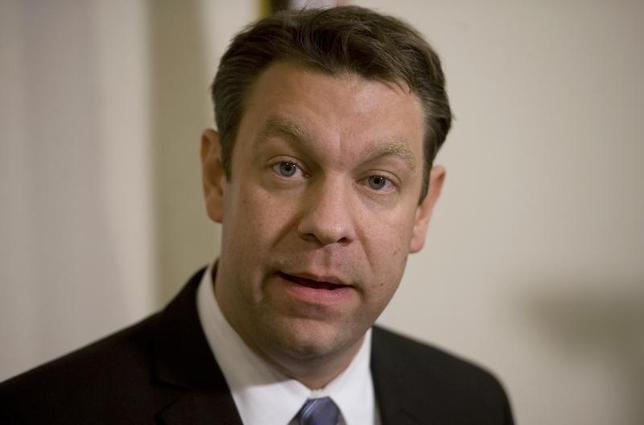 Rep. Henry ''Trey'' Radel (R-FLA) talks to the local media during a news conference at his district office in Cape Coral, Florida, November 20, 2013. REUTERS/Steve Nesius