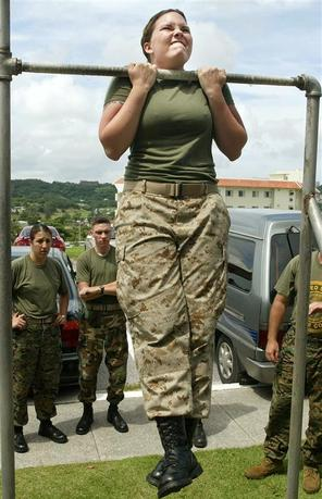 U.S. Marines Lance Corporal Shawn Vincent grimaces as she practices pull-ups at Camp Foster on the southern Japanese island of Okinawa in this June 20, 2003 file photo. REUTERS/Eriko Sugita/Files