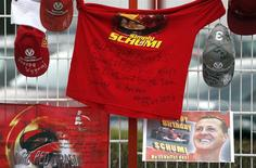 Caps, flags and a shirt marking the 45th birthday of seven-times former Formula One world champion Michael Schumacher are placed outside his cart racing track, in the western city of Kerpen January 3, 2014. REUTERS/Ina Fassbender