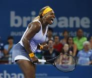 Serena Williams of the U.S. reacts to a won point during her defeat of Belarus' Victoria Azarenka in the women's singles final in the Brisbane International tennis tournament in Brisbane, January 4, 2014. REUTERS/Jason Reed