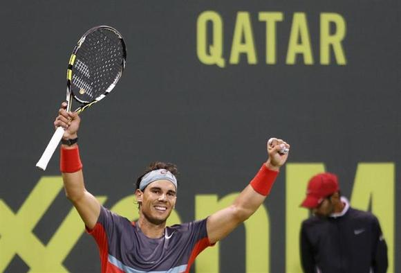 Rafael Nadal of Spain celebrates after defeating Gael Monfils of France during their men's singles final match of the Qatar Open tennis tournament in Doha January 4, 2014. REUTERS/Ahmed Jadallah