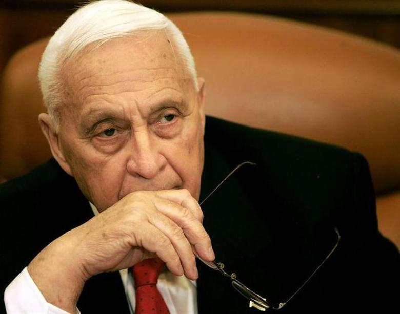 Israeli Prime Minister Ariel Sharon attends a ceremony completing the sale of Bank Leumi to a private U.S. investment group in his office in Jerusalem January 4, 2006. REUTERS/Eliana Aponte
