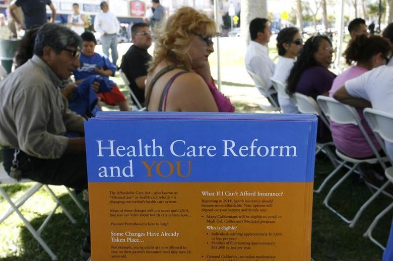 People gather for information during a Planned Parenthood Affordable Care Act outreach event for the Latino community in Los Angeles, California September 28, 2013. REUTERS/Jonathan Alcorn