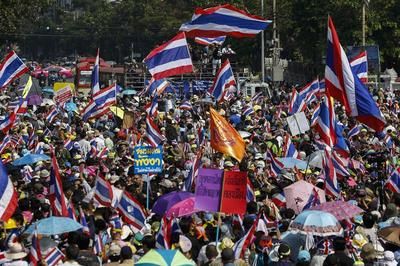 Thai protesters march again in bid to bring down...