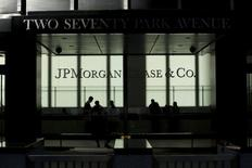 People walk inside JP Morgan headquarters in New York, October 25, 2013. REUTERS/Eduardo Munoz