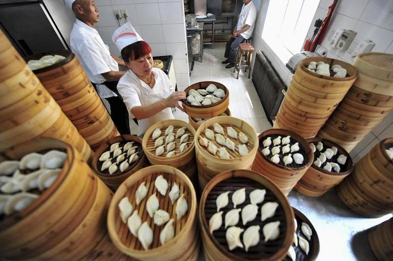 A cook arranges baskets of newly-made dumplings at a restaurant in Shenyang, Liaoning province July 13, 2013. REUTERS/Stringer