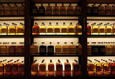 Bottles of Suntory Holdings single cask whisky are displayed at its Yamazaki Distillery in Shimamoto town, Osaka prefecture December 15, 2013. REUTERS/Sophie Knight