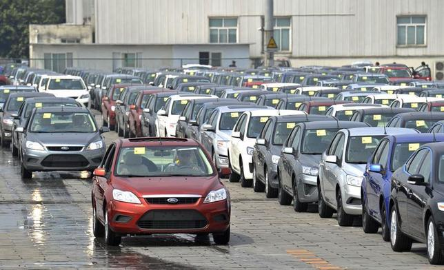 Employees drive newly assembled Ford cars into the parking lot of a Ford manufacturing plant in Chongqing municipality April 20, 2012. REUTERS/Stringer