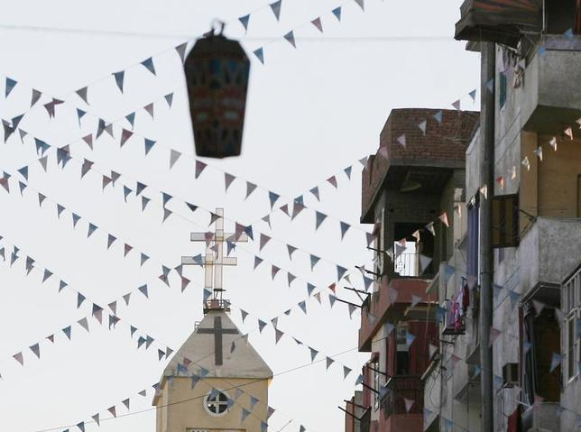 A cross of an Egyptian Coptic Orthodox church is seen under a ''Fanous'' decorated lantern in the town of Nagaa Hamady, in Qena, 700 km (435 miles) south of Cairo, January 9, 2010. REUTERS/Asmaa Waguih
