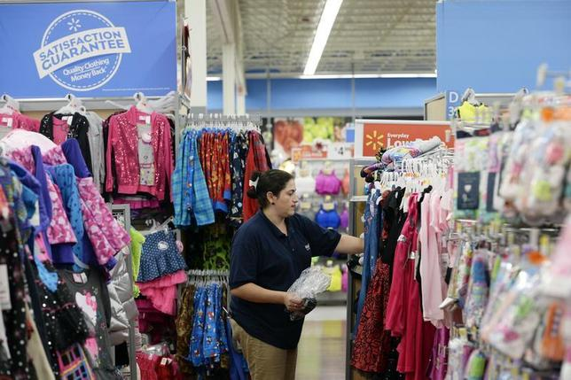 A worker stocks merchandise at the Wal-Mart Superstore in the Porter Ranch section of Los Angeles November 26, 2013. REUTERS/Kevork Djansezian