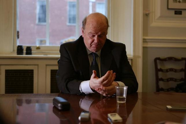 Irish Minister for Finance Michael Noonan gestures during an interview with Reuters at his offices in central Dublin December 16, 2013. REUTERS/Cathal McNaughton