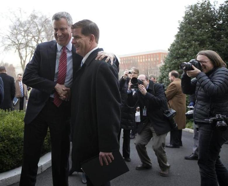 New York Mayor-elect Bill de Blasio (L) and Boston Mayor-elect Martin Walsh are pictured after speaking to the press outside the West Wing of the White House in Washington, December 13, 2013, following their meeting with U.S. President Barack Obama and other newly-elected mayors about job creation. REUTERS/Jason Reed