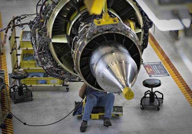 A worker carries out the final preparations on an engine for the Boeing 737-900 at their assembly operations in Renton, Washington, October 18, 2012. REUTERS/Andy Clark