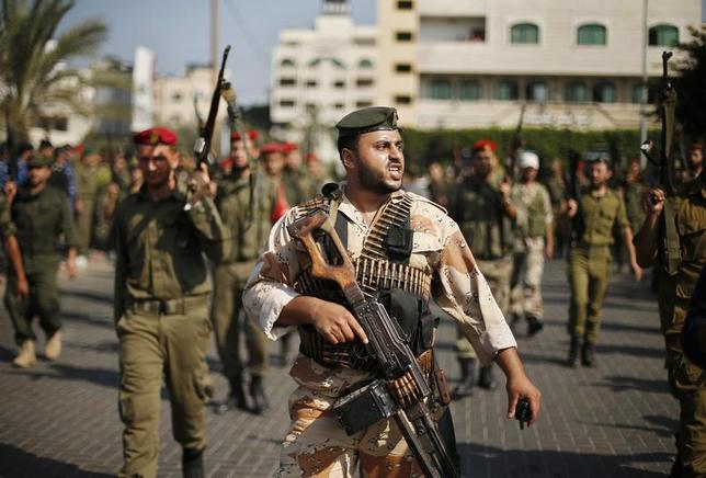 Members of Palestinian security forces loyal to Hamas march on a street in Gaza City. REUTERS/Suhaib Salem
