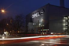 Cars drive past the Opel plant in Bochum April 17, 2013. REUTERS/Ina Fassbender