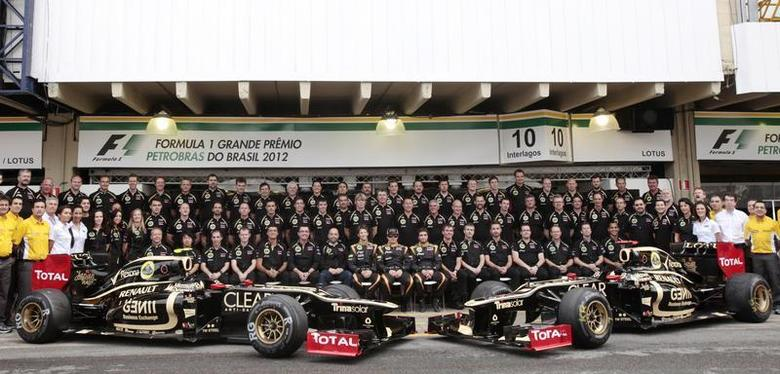 Lotus Formula One team pose during a photo call before the Brazilian F1 Grand Prix at Interlagos circuit in Sao Paulo November 25, 2012. REUTERS/Sergio Moraes
