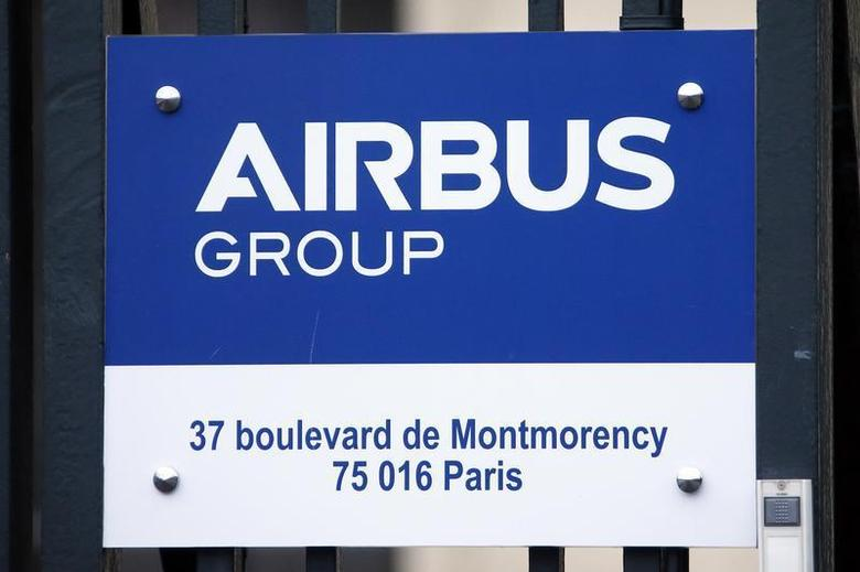 A sign shows the new logo of aircraft manufacturer Airbus Group on the entrance gate of the company's office building in Paris January 3, 2014. REUTERS/Benoit Tessier