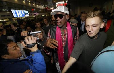 Rodman lands in North Korea for basketball on Kim's...