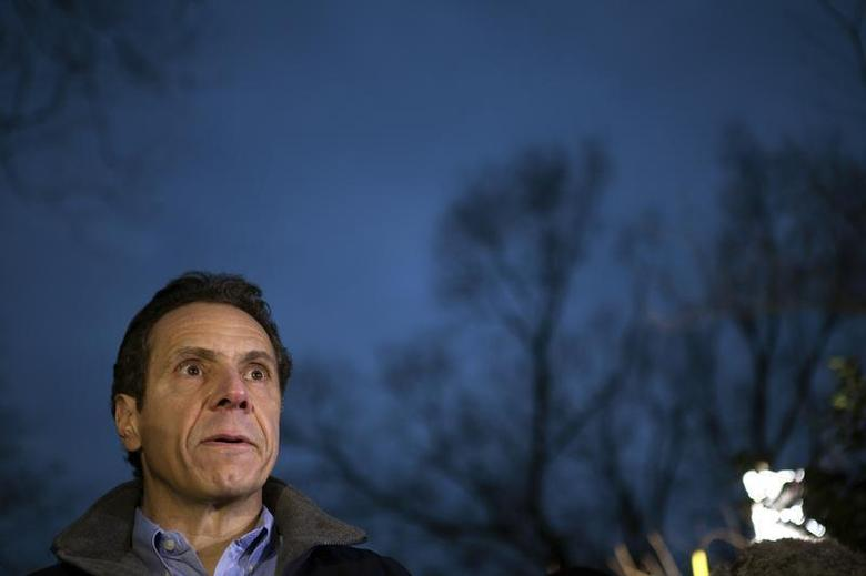 New York Governor Andrew Cuomo gives a news conference after a Metro North train derailment in the Bronx borough of New York December 1, 2013. REUTERS/Carlo Allegri