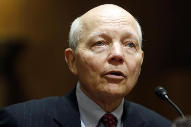 John Koskinen testifies before a Senate Finance Committee confirmation hearing on his nomination to be commissioner of the Internal Revenue Service (IRS) on the Capitol Hill in Washington, December 10, 2013. REUTERS/Jonathan Ernst