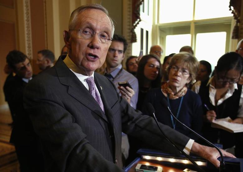 U.S. Senate Majority Leader Harry Reid (D-NV) speaks to the media following a Senate cloture vote on budget bill on Capitol Hill in Washington December 17, 2013. REUTERS/Yuri Gripas