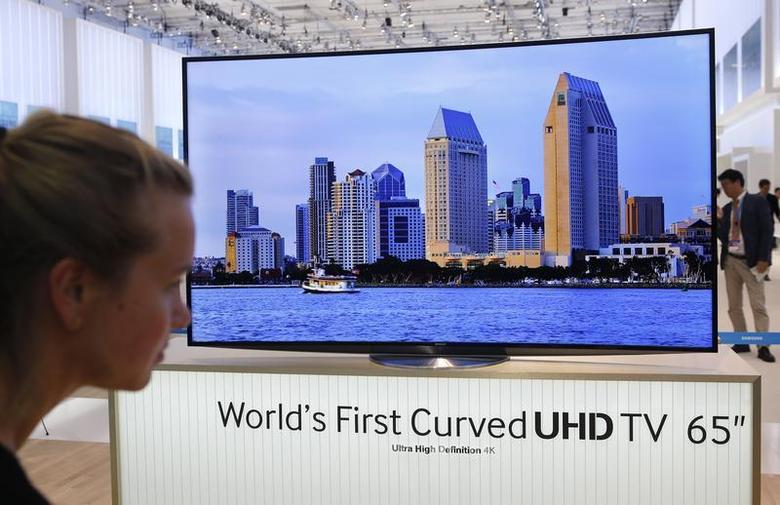 A women looks at the world's first curved UHD TV 55'' 4K screen at the booth of Samsung during a media preview day at the IFA consumer electronics fair in Berlin, September 5, 2013. REUTERS/Fabrizio Bensch/Files
