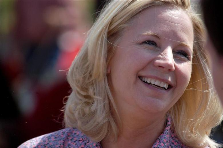 U.S. Senate candidate Liz Cheney speaks with voters during a Republican and Tea Party gathering in Emblem, Wyoming in this August 24, 2013, file photo. REUTERS/Ruffin Prevost/Files