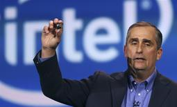 Intel CEO Brian Krzanich introduces Intel's Edison, a new personal computer in the size of an SD card, during the annual Consumer Electronics Show (CES) in Las Vegas, Nevada January 6, 2014. REUTERS/Robert Galbraith