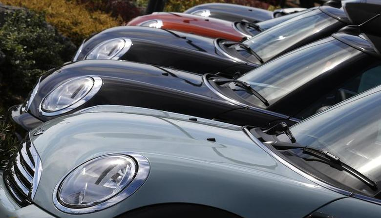 New Mini cars are parked outside a Mini dealership in Brighton in southern England August 6, 2013. REUTERS/Luke MacGregor
