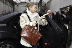 Corinna Schumacher (L), wife of former Formula One world champion Michael Schumacher, and Professor Gerard Saillant (R), president of the Institute for Brain and Spinal Cord Disorders (ICM), arrive at the CHU hospital emergency unit where Schumacher is hospitalized, in Grenoble, French Alps January 4, 2014. REUTERS/Emmanuel Foudrot