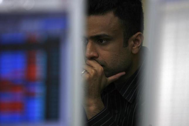 A broker reacts while trading at a brokerage firm in Mumbai November 27, 2009. REUTERS/Arko Datta/Files