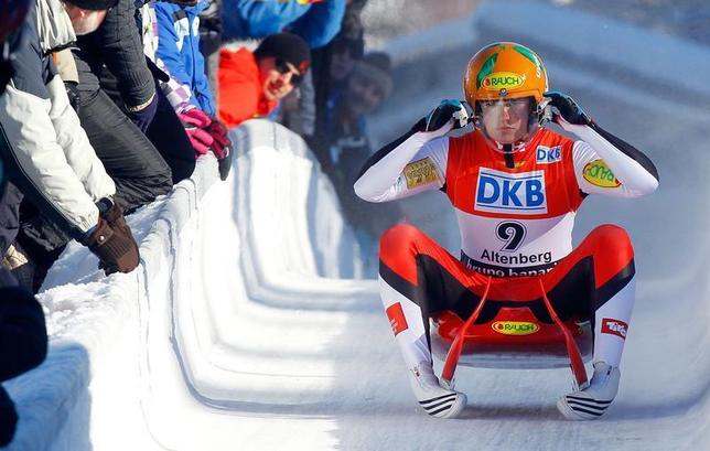Austria's Nina Reithmayer reacts in the finish area during the FIL Luge World Championships in Altenberg February 12, 2012. REUTERS/Dominic Ebenbichler
