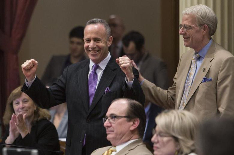 California Senate president pro tempore Darrell Steinberg (D-Sacramento) celebrates as his bill SB743 passes, which modifies the California Environmental Quality Act, at the State Capitol in Sacramento, California, September 12, 2013. REUTERS/Max Whittaker