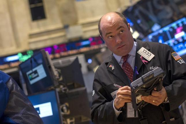 A trader works on the floor of the New York Stock Exchange January 6, 2014. REUTERS/Brendan McDermid