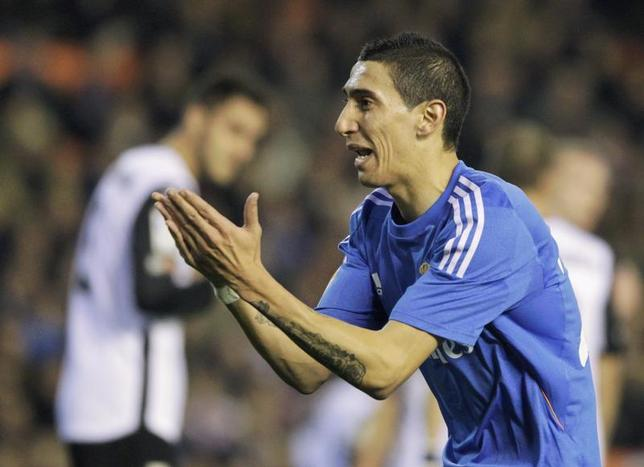 Real Madrid's Angel Di Maria celebrates after he scored against Valencia during their Spanish first division soccer match at the Mestalla stadium in Valencia December 22, 2013. REUTERS/Stringer