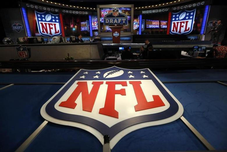 The NFL logo and set are seen at New York's Radio City Music Hall before the start of the 2013 NFL Draft April 25, 2013. REUTERS/Shannon Stapleton