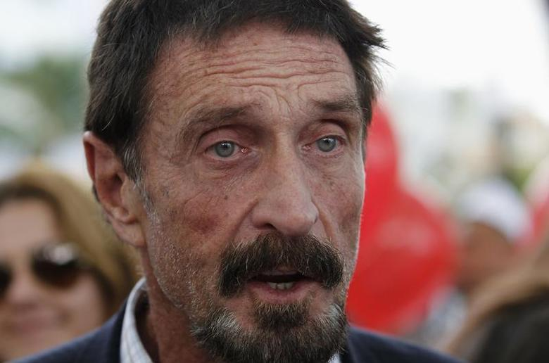 Computer software pioneer John McAfee speaks with reporters outside his hotel in Miami Beach, Florida December 13, 2012. REUTERS/Joe Skipper