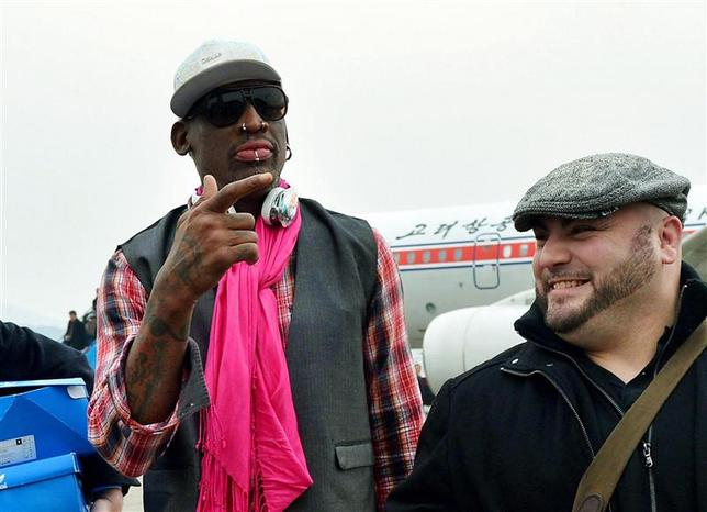 Former NBA basketball star Dennis Rodman (L) arrives at Pyongyang airport in Pyongyang, in this photo released by Kyodo January 6, 2014. REUTERS/Kyodo