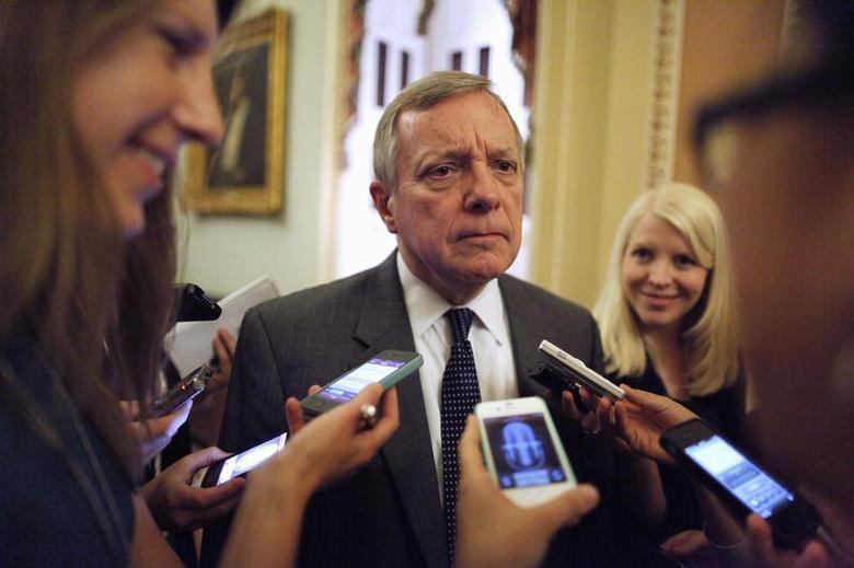 U.S. Senator Richard Durbin (D-IL) talks with reporters near the U.S. Senate floor at the U.S. Capitol during immigration debates in Washington, June 20, 2013. REUTERS/Jonathan Ernst