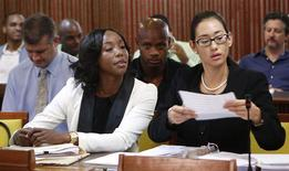 Jamaica's Olympic sprinter Sherone Simpson (front L), who tested positive for doping at the Jamaican Championships in 2013, sits with her attorney Dianne Chai (front R), as they wait for the beginning of the hearing before the country's anti-doping commission in Kingston January 7, 2014. REUTERS/Gilbert Bellamy