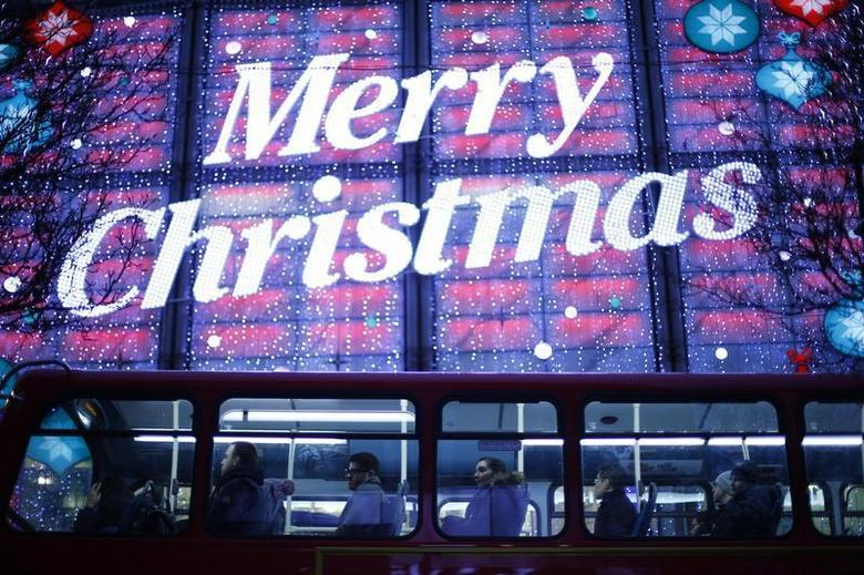 Passengers ride a double decker bus past Christmas lights on Oxford Street, in London, December 24, 2012. REUTERS/Andrew Winning